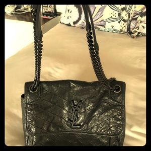 Saint Laurent gray leather bag with YSL duster